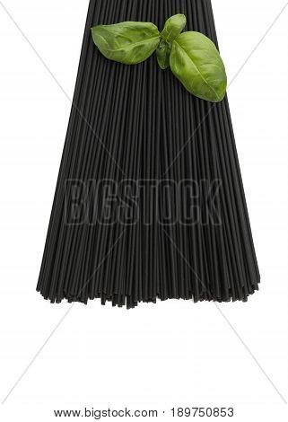 squid ink black spaghetti vertical image with a basil garnish  on an isolated white background copy space at the base