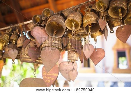 Many golden buddhist bells with wishes In a Buddhist temple. religion