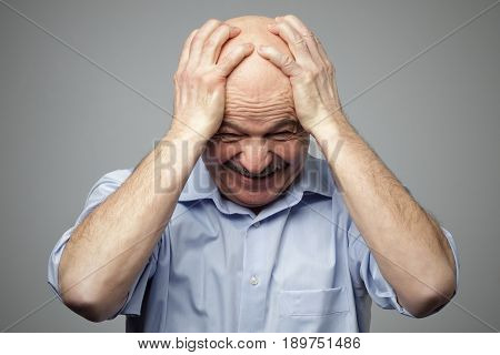 Elderly Man In Despair Grabs His Head. Problems With Money, At Work, In The Family