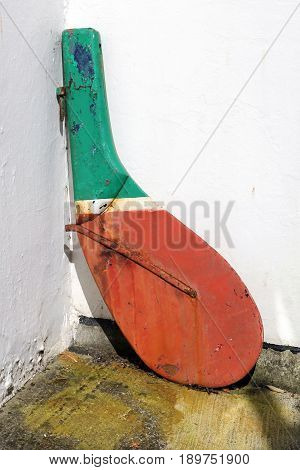 An old rudder from a fishing boat or rawler being used as a decorative item in a back yard