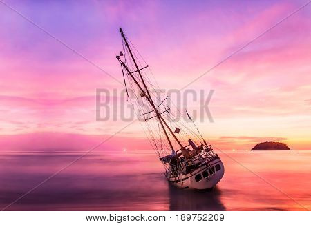 Boat On The Beach In Twilight And Colorful Of Sunset