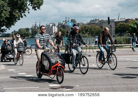 Copenhagen Denmark - August 10 2016. Cyclists crossing the street in Copenhagen. The bicycle is the typical mode of transport in Denmark