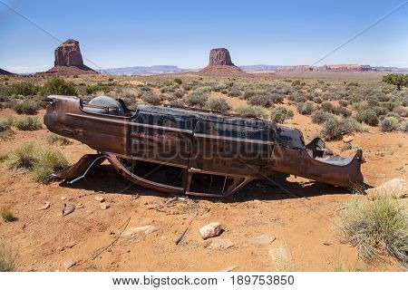 An abandoned car located in the Monument Valley Desert, Utah