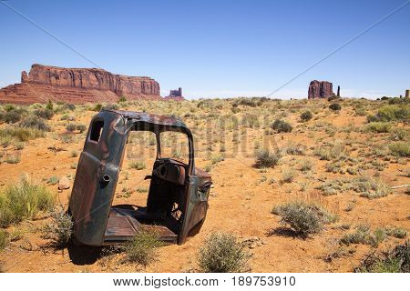 An abandoned truck cab in the Monument Valley desert, Utah