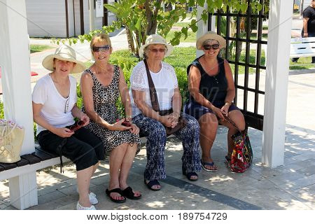 31ST MAY 20176, FETHIYE,TURKEY: Four lady English tourists having a rest in a seating area during the summertime in fethiye in turkey,31st may 2017