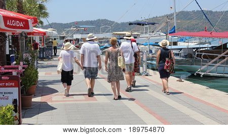 31ST MAY 2017,FETHIYE, TURKEY: Tourists walking along the promanade in the port of Fethiye in Turkey, 31st may, 2017