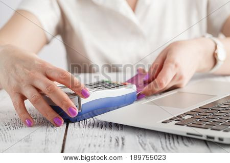 Woman Hands Insert White Credit Card Into Credit Card Machine (pos Terminal)