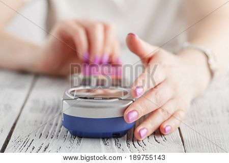 Woman using credit card to pay in pos