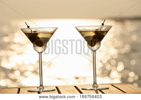 Two Martini Cocktails At The Wooden Pier At Sunset. Luxury Resort Vacation Concept. Festive Relax Ge
