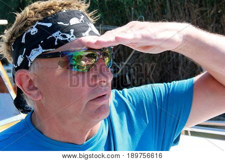 1ST JUNE 2017, FETHIYE, TURKEY: An unknown Englishman  wearing a bandana and cool sunglasses while on vacation in turkey, 1st june 2017