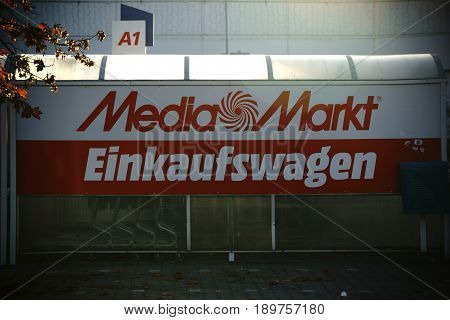 MAINZ, GERMANY - OCTOBER 29: The red illuminated company logo of the electronics and HIFI market Media Market at a shelter for shopping carts on October 29 2016 in Mainz.