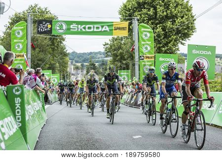 Bouille-MenardFrance - July 4 2016: The peloton riding during the stage 3 of Tour de France in Bouille-Menard on July 4 2016.