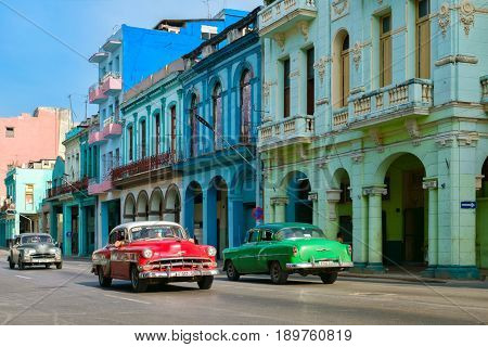 HAVANA,CUBA - JUNE 1, 2017 : Old american cars in a colorful street in downtown Havana