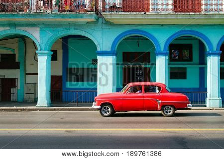 HAVANA,CUBA - JUNE 1, 2017 : Classic american car in a colorful street in downtown Havana