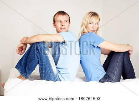 husband and wife have a quarrel at home,  sit on the bed