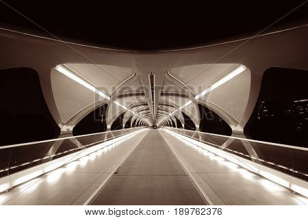 CALGARY, CANADA - AUGUST 27: Peace Bridge at night on August 27, 2015 in Calgary, Canada. Designed by Santiago Calatrava, the pedestrian bridge connect across Bow River and the landmark of the city.