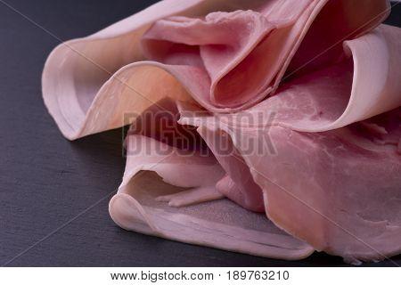 pork ham slices on the slate background