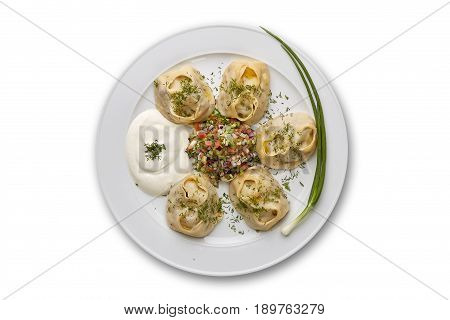 Manti with sour cream on white background isolation