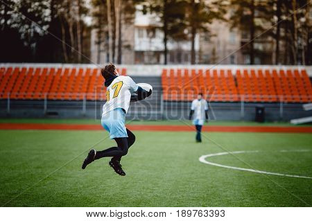 guy with the team is throwing throwing and catching with flying disk at the sports stadium. The concept of the game is active and mobile in summer. Disk for throwing