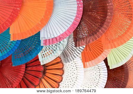 Colorful spanish hand fans for sale in a street market
