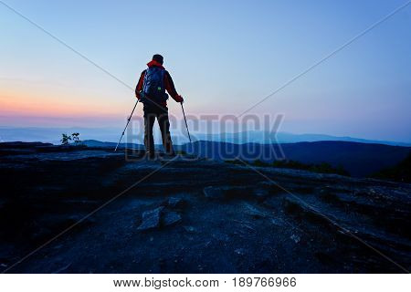 Man Tourist With Trekking On Top Of Hill