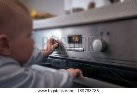 dangerous situation the child is playing with an electric stove. The child plays near a hot stove.