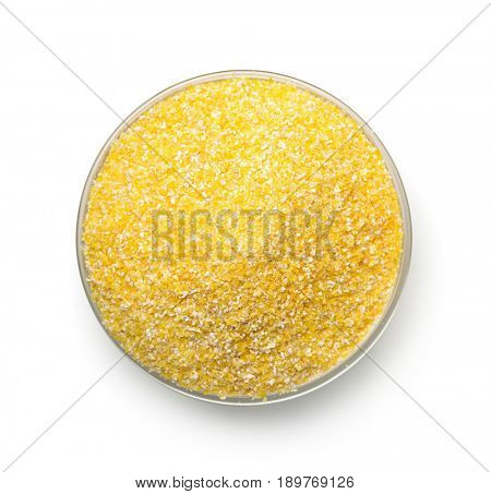 Top view of bowl with corn grits isolated on white