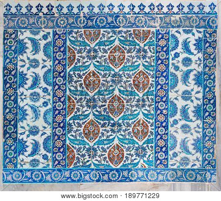 Istanbul, Turkey - April 24, 2017: Old ceramic wall tiles with floral blue pattern in an exterior wall of the historic Eyup Sultan Mosque situated in the Eyup district Istanbul Turkey