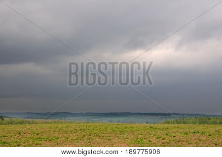 Spring landscape, field on a cloudy day