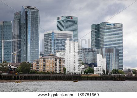 LONDON/UK - MAY 20 : Riverside apartment and business buildings in Canary Wharf, which is London's main financial district and has many international banks such as HSBC and City bank