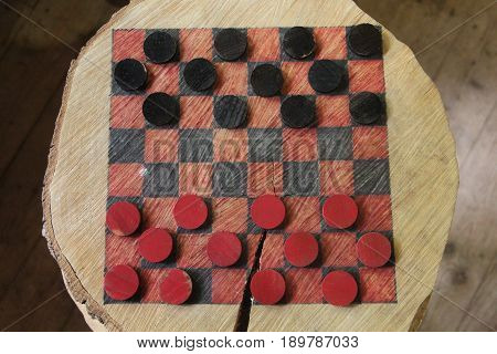 An American homemade wooden checker board inside