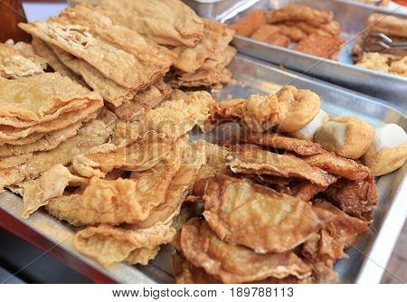 closeup of  fried asian food in steel trayer