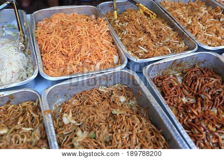 closeup of chinese chow mein noodles in trays