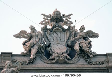 ROME, ITALY - SEPTEMBER 01: Coat-of-arms of Pope Clement XII on the Trevi Fountain in Rome. Fontana di Trevi is one of the most famous landmark in Rome, Italy on September 01,2016.