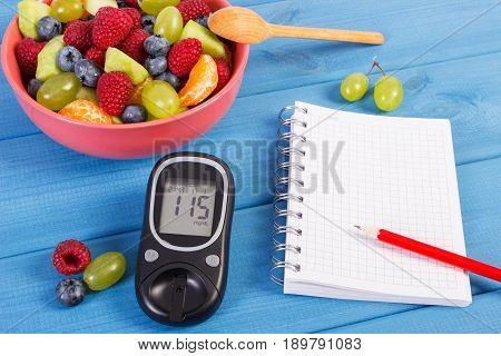 Fruit Salad, Glucose Meter And Notepad For Notes, Diabetes, Healthy Lifestyle And Nutrition Concept