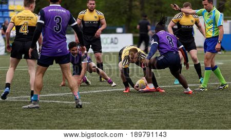 ST. PETERSBURG, RUSSIA - MAY 27, 2017: Match team St. Petersburg (black and yellow) vs RC Geneve, Switzerland during Rugby Europe Sevens Club Champion's Trophy. The city hosts the trophy in 2nd time