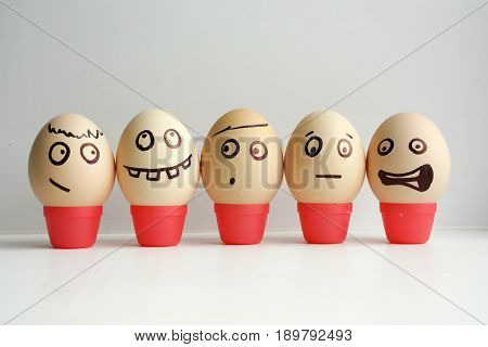 Eggs With Painted Face. Concept