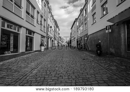 SCHWEINFURT GERMANY - APRIL 21 2017: Old streets in the historic part of the city. Black and white. Schweinfurt - a medieval city founded in 761 year.