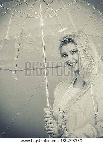 Happy Woman Wearing Raincoat Holding Transparent Umbrella