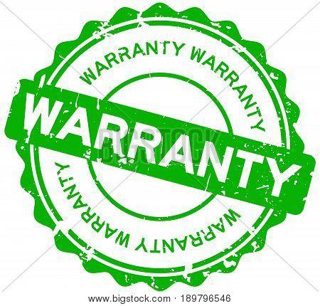 Grunge green warranty round rubber seal stamp on white background