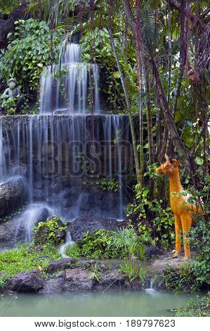 Phalanchai Waterfall artificial waterfall and imitation zoo located in public park on a small island in Bung Phalanchai Lake Roi Et Province northeastern Thailand