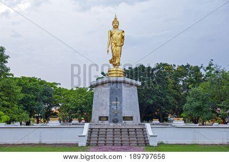 Statue Of Walking Buddha Enshrined At Bung Phalanchai Lake, Roi Et Province, Northeastern Thailand