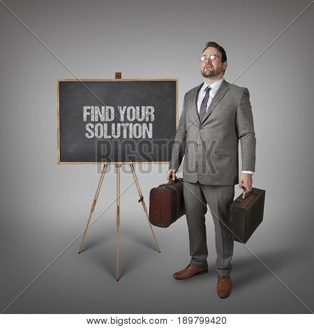 Find your solution text on  blackboard with businessman carrying suitcases