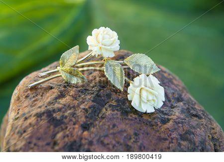 Vintage brooch. Close-up. White Rose