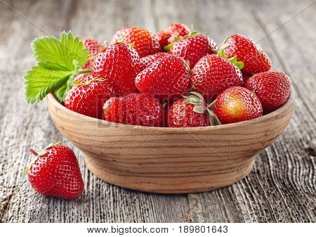 Strawberry in a wooden plate