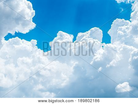 Big White Cloud And Light Ray Behind Cloud With Blue Sky