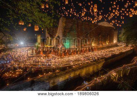Light waving of candle rite walk on Visakha Puja Day at Watmaheyong in Ayutthaya, Thailand.