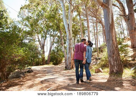 Romantic Couple Hiking Along Forest Path Together