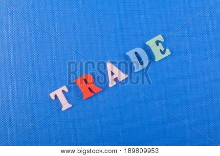 TRADE word on blue background composed from colorful abc alphabet block wooden letters, copy space for ad text. Learning english concept