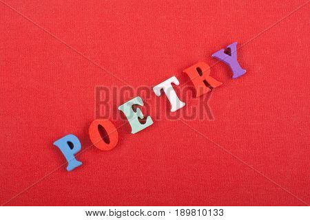 POETRY word on red background composed from colorful abc alphabet block wooden letters, copy space for ad text. Learning english concept